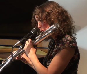 Annie Parker playing bass flute